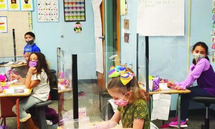 Elementary students return to hybrid learning