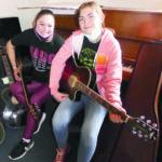 Magdalena music students play Urban guitars